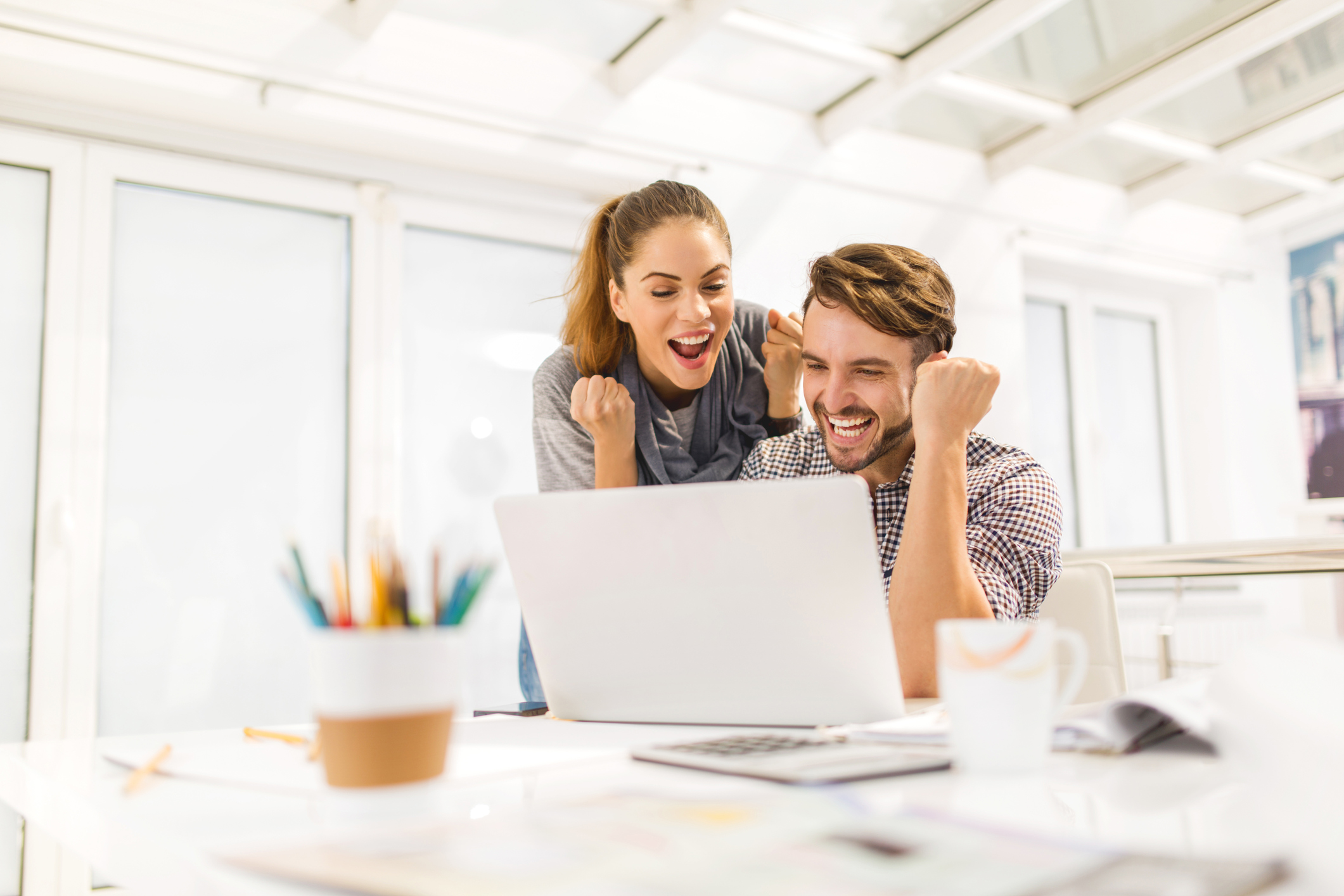 Man and woman excited about changing the culture of their organization