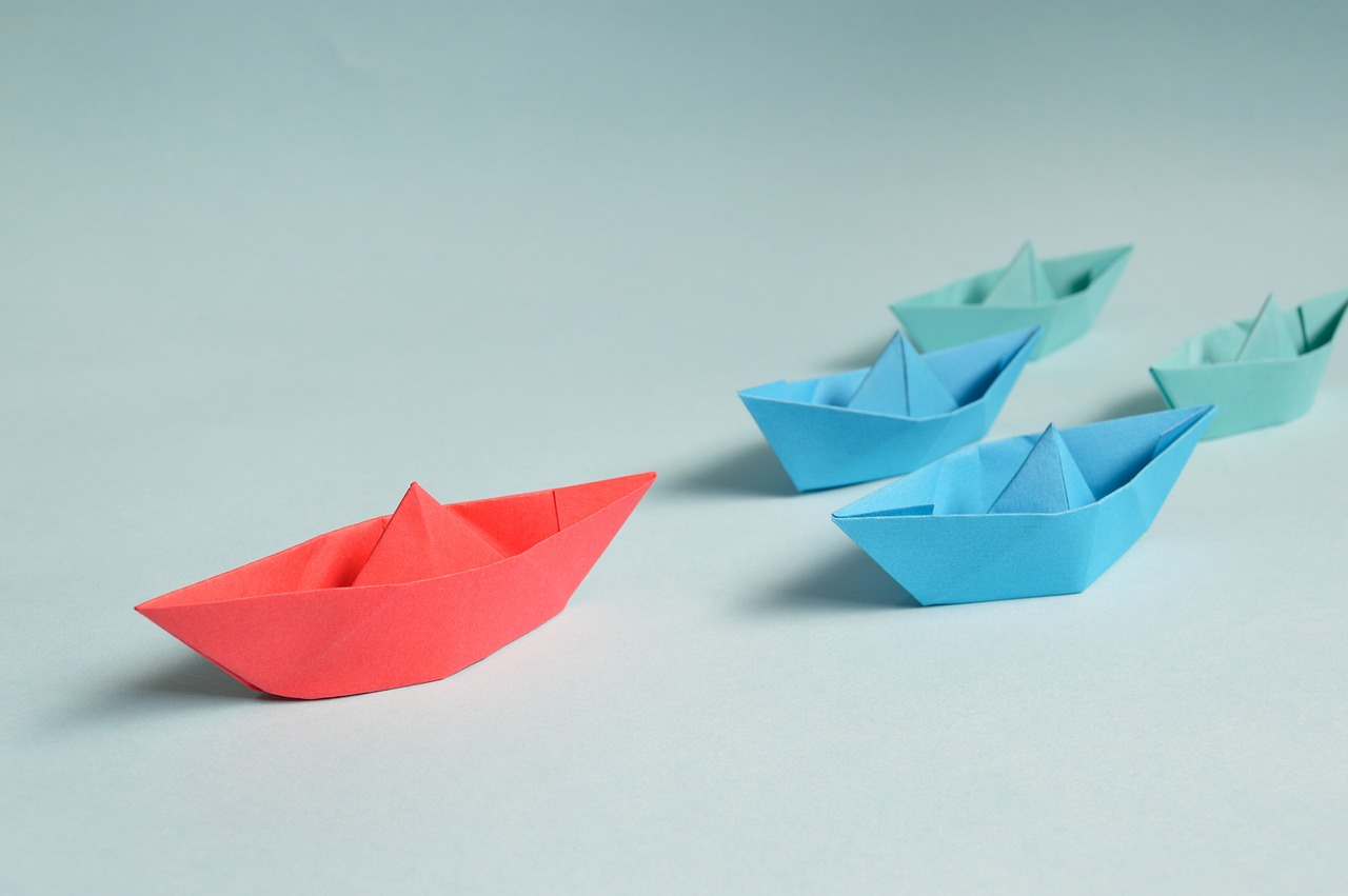 Paper boats to illustrate Finding New Ways of Working
