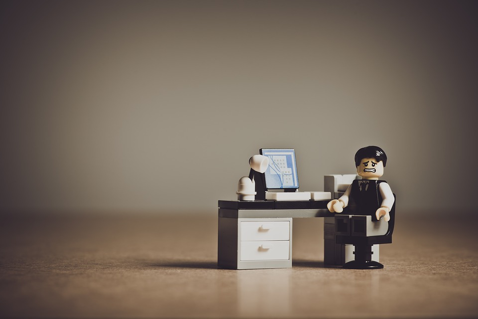 image of a lego man working